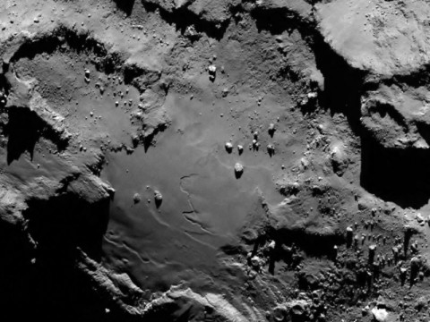 Close up detail focusing on a smooth region on the 'base' of the 'body' section of comet 67P/Churyumov-Gerasimenko. The image was taken by Rosetta's Onboard Scientific Imaging System (OSIRIS) on August 6, 2014. (ESA/Rosetta/MPS for OSIRIS Team)