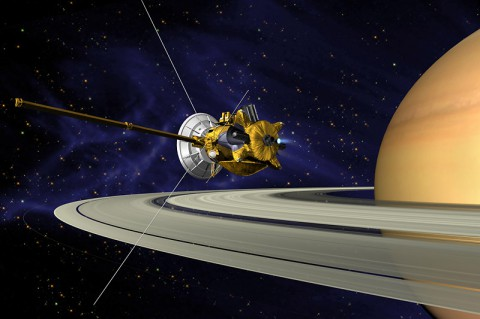 This is an artists concept of the Cassini Spacecraft orbiting Saturn Orbit. (NASA/JPL)
