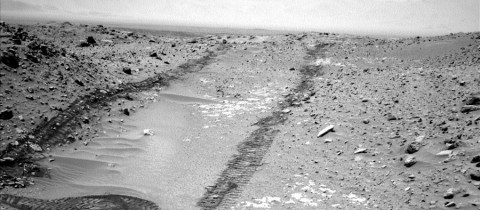 "In this image from NASA's Curiosity Mars rover looking up the ramp at the northeastern end of ""Hidden Valley,"" a pale outcrop including drilling target ""Bonanza King"" is at the center of the scene. (NASA/JPL-Caltech)"