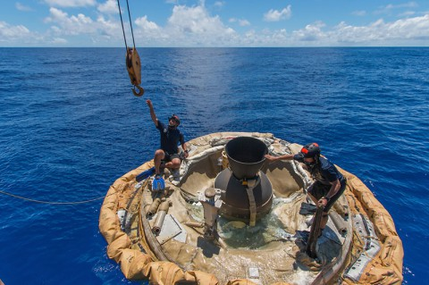 Divers retrieve the test vehicle for NASA's Low-Density Supersonic Decelerator off the coast of the U.S. Navy's Pacific Missile Range Facility in Kauai, Hawaii. (NASA/JPL-Caltech)