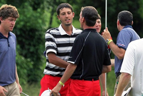 Dustin Korte shakes hands with former APSU coach Kirk Kayden after Korte birdied his final hole as a Governor at the 2013 NCAA Championship in Alpharetta, Georgia. (APSU Sports Information)