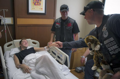 "A Soldier with the 5th Special Forces Group (Airborne), shakes the hand of a patient of the Children's Hospital at TriStar Centennial of Nashville, Sept. 26, 2014, while conducting a ""teddy bear run."" The Soldiers rode from Fort Campbell to deliver teddy bears to the patients of the hospital in an attempt to brighten their day. (U.S. Army photo by Sgt. Justin A. Moeller, 5th SFG (A) Public Affairs)"