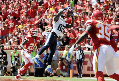 Tennessee Titans tight end Delanie Walker (82) catches a touchdown pass in front of Kansas City Chiefs cornerback Sean Smith (21) in the first half at Arrowhead Stadium September 7th, 2014. (John Rieger-USA TODAY Sports)