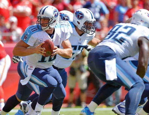 Tennessee Titans quarterback Jake Locker (10) looks to hand off during the first half against the Kansas City Chiefs at Arrowhead Stadium. (Denny Medley-USA TODAY Sports)