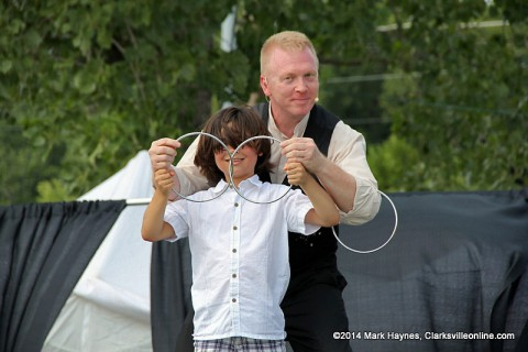 Magician Russ Nowack performing at the 2014 Clarksville Riverfest Festival.