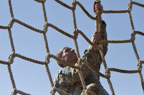 """Command Sgt. Maj. David J. Tookmanian, a native of Hillsdale, N. J., and command sergeant major of the 716th Military Police Battalion """"Peacekeepers,"""" 101st Sustainment Brigade, 101st Airborne Division (Air Assault), climbs a cargo rope at the Special Forces obstacle course during the Peacekeeper Challenge competition, Aug. 21, 2014, at Fort Campbell, Ky.  (U.S. Army photo by Sgt. Sinthia Rosario)"""