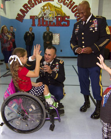 """Lt. Col. Alexander Gallegos (right), commander of 101st Special Troops Battalion """"Sustainers,"""" 101st Sustainment Brigade """"Lifeliners,"""" 101st Airborne Division, along with Command Sgt. Maj. Christopher Crawford, senior enlisted adviser, 101st STB, talk to students at Marshall Elementary School during an assembly Sept. 11. Soldiers also read stories to students and discussed the importance of 9/11 in American history. (U.S. Army photo by Sgt. Leejay Lockhart, 101st Sustainment Brigade Public Affairs)"""
