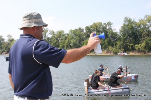 Kevin Cowling kicks off the plastic bottle boat division at the 2014 Riverfest Regatta