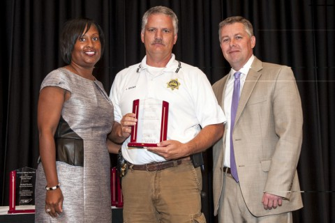 Governor's Highway Safety Office Assistant Director Mia Vickers (left) and GHSO Director Kendell Poole (right) present Sgt. Jimmy Brown with the Director's Award.