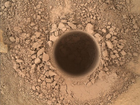 This image from the Mars Hand Lens Imager (MAHLI) camera on NASA's Curiosity Mars rover shows the first sample-collection hole drilled in Mount Sharp, the layered mountain that is the science destination of the rover's extended mission. (NASA/JPL-Caltech/MSSS)