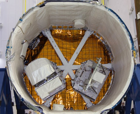 RapidScat's two-part payload is shown in the trunk of a SpaceX Dragon cargo spacecraft at NASA's Kennedy Space Center in Florida. (NASA)