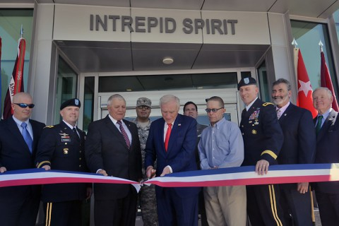 Staff Sgt. Todd Domorese, Maj. Gen. Richard W. Thomas, retired Gen. Richard Cody, Spc. Miguel Hernandez, Arnold Fisher, Dave Winters, Sgt. Maj. Robert Haemmerle, Maj. Gen. Gary J. Volesky, Dr. Brett Logan, and retired Lt. Gen. Edgar Anderson help cut the ribbon at the Intrepid Fallen Heroes Fund dedication of the new Intrepid Spirit Center, on Monday, Sept. 8, 2014 at Fort Campbell, KY. (Dean Dixon/AP Images for AP Images for Intrepid Fallen Heroes)