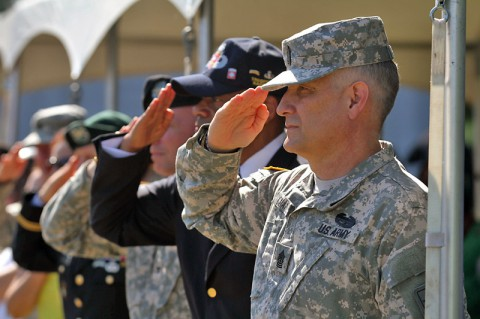 Sergeant Major of the Army Raymond F. Chandler III renders a hand salute as the colors are being posted during the 555th Parachute Infantry Association monument dedication, Sept. 4, 2014, at Fort Campbell, Ky. (U.S. Army photo by Staff Sgt. Candice Funchess, 101st Airborne Division (Air Assault) Public Affairs)