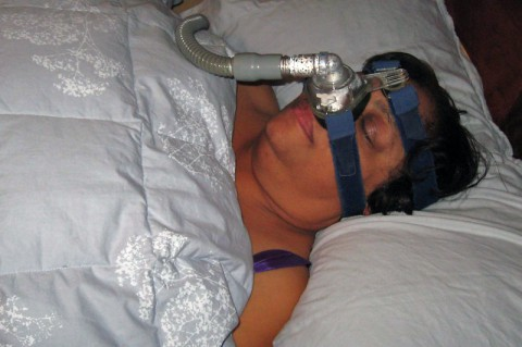 Sleep Apnea - Woman wearing CPAP. (American Heart Association)