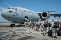 A group of 30 U.S. military personnel, including Marines, Airmen, and Soldiers from the 101st Airborne Division, board a U.S. Air Force C-17 Globemaster III at Léopold Sédar Senghor International Airport in Dakar, Senegal, Oct. 19, 2014. The service members are bound for Monrovia, Liberia, where U.S. troops will construct medical treatment units and train health care workers as part of Operation United Assistance, the U.S. Agency for International Development-led, whole-of-government effort to respond to the Ebola outbreak in West Africa. (Maj. Dale Greer/U.S. Air National Guard)