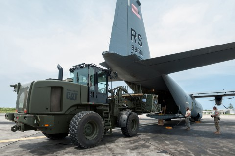 Aerial porters from the Kentucky Air National Guard's 123rd Contingency Response Group load a pallet of red blood cells and frozen plasma onto a C-130 Hercules aircraft from Ramstein Air Base, Germany, Oct. 10, 2014, at Léopold Sédar Senghor International Airport in Dakar, Senegal. The aerial porters are part of Joint Task Force-Port Opening Sengal, an air cargo hub that's funneling humanitarian supplies and equipment into West Africa in support of Operation United Assistance, the U.S. Agency for International Development-led, whole-of-government effort to respond to the Ebola outbreak there. (Maj. Dale Greer/U.S. Air National Guard)