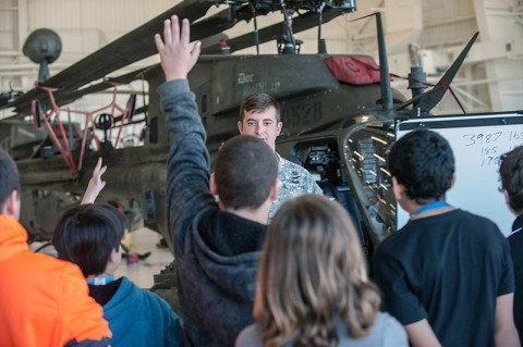 Chief Warrant Officer 2 Frank Laudano, OH-58D Kiowa Warrior helicopter pilot, Headquarters and Headquarters Troop, 2nd Squadron, 17th Cavalry Regiment, 101st Combat Aviation Brigade, 101st Airborne Division (Air Assault), responds to raised hands from visiting students, here, Oct. 8, 2014. The field trip by Kenwood Middle School sixth-graders was part of a broader field trip to make mathematics meaningful outside of the classroom. (Sgt. Duncan Brennan, 101st CAB Public Affairs)