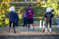 U.S. Army Sgt. 1st Class Christopher Roberts, food service sergeant with 3rd Battalion, 5th Special Forces Group (Airborne), explains a play to the children of his football team, Oct. 21, 2014. The team he coaches is part of the Bud Hudson Youth Football League of the Boys and Girls Club of America in Christian County, Ky. (Sgt. Justin A. Moeller/U.S. Army)