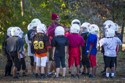 U.S. Army Sgt. 1st Class Christopher Roberts, food service sergeant with 3rd Battalion, 5th Special Forces Group (Airborne), talks to the children of his football team, Oct. 21, 2014. The team he coaches is part of the Bud Hudson Youth Football League of the Boys and Girls Club of America in Christian County, Ky. (Sgt. Justin A. Moeller/U.S. Army)