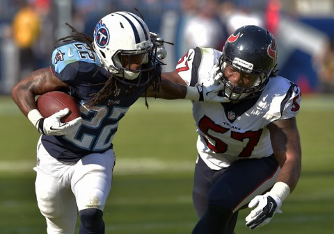 Tennessee Titans running back Dexter McCluster (22) carries the ball against Houston Texans linebacker Justin Tuggle (57) during the second half at LP Field. The Texans beat the Titans 30-16. (Don McPeak-USA TODAY Sports)