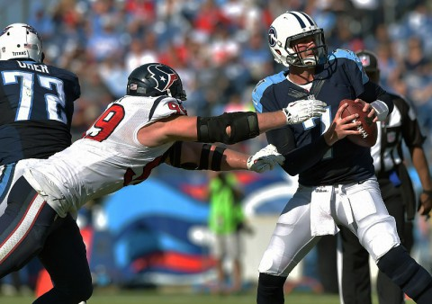 Tennessee Titans quarterback Zach Mettenberger (7) is sacked by Houston Texans defensive end J.J. Watt (99) during the second half at LP Field.  (Don McPeak-USA TODAY Sports)