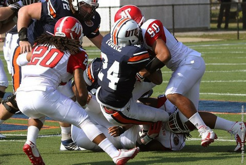 Austin Peay's Antonio Turner (50) stuffs UT Martin Abou Toure in the first quarter against UT Martin. (APSU Sports Information)