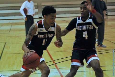 Austin Peay junior guard Khalil Davis drives on fellow newcomer, Josh Robinson, during practice. (APSU Sports Information)