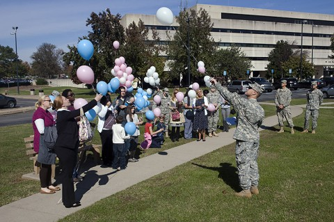 During a Walk To Remember ceremony at Blanchfield Army Community Hospital, Chaplain (Maj.) Thomas Gidley leads attendees in a balloon release to honor the memories of babies lost. (U.S. Army photo by David E. Gillespie)