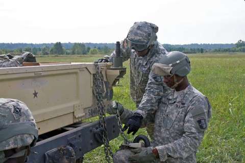 """First Sgt. Brian K. Walker, 584th Support Maintenance Company """"Warpath,"""" 129th Combat Sustainment Support Battalion, 101st Sustainment Brigade, 101st Airborne Division, explains to Staff Sgt. Darris A. Rutherford, a wheeled vehicle mechanic with the 584th SMC, how to properly hook the chain links to a Humvee as they rig the vehicle during a field training exercise, Sept. 18, at Fort Campbell. The Soldiers of the 584th are training on how to properly and effectively rig their equipment. (Sgt. Sinthia Rosario, 101st Sustainment Brigade Public Affairs)"""