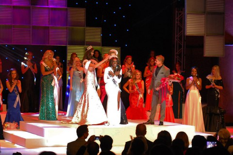 Miss Tennessee USA 2015, Kiara Young, accepts her crown from Miss Tennessee USA 2014, Kristy Landers Niedenfuer, and Miss Tennessee Teen USA 2015, Hannah Faith Greene.