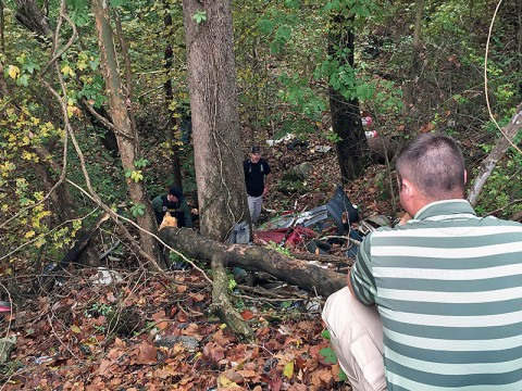 Montgomery County Sheriff's Deputies search an area behind a body shop on Highway 48 for a juvenile who escaped custody from a Middle Tennessee Juvenile Detention transport.