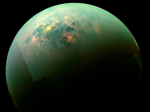 This near-infrared, color view from Cassini shows the sun glinting off of Titan's north polar seas. (NASA/JPL-Caltech/Univ. Arizona/Univ. Idaho)