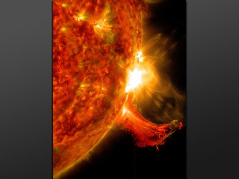 NASA's Solar Dynamics Observatory captured this image of a solar flare on Oct. 2nd, 2014. The solar flare is the bright flash of light on the right limb of the sun. A burst of solar material erupting out into space can be seen just below it. (NASA/SDO)