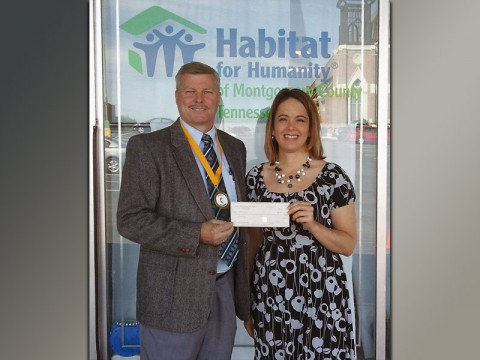 Sango United Methodist Church Pastor Willie Lyle and Shelby Logsdon, executive director of Habitat for Humanity.