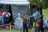 """More than 2,500 Soldiers and their families came out to enjoy fun attractions such as """"trunk-or-treating""""."""