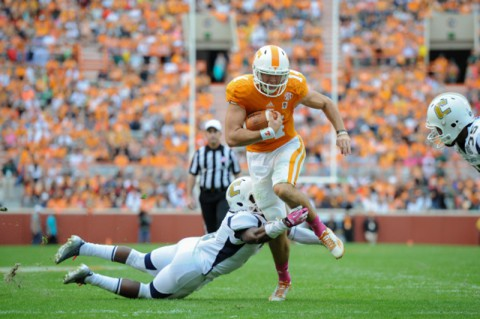 Quarterback Justin Worley #14 of the Tennessee Volunteers runs for a touchdown during the Homecoming game between the UT Chattanooga Mocs and the Tennessee Volunteers at Neyland Stadium in Knoxville, TN. (Randy Sartin/Tennessee Athletics)