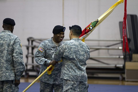 Command Sgt. Maj. Christopher T. Crawford, the outgoing senior adviser for the101st Special Troops Battalion, 101st Sustainment Brigade, 101st Airborne Division, passes the battalion colors to Lt. Col. Alexander Gallegos, the commander of the 101st STB, during a change of responsibility ceremony Oct. 28 at Fort Campbell, Ky. During the ceremony, Crawford relinquished his responsibilities as senior adviser of the 101st STB to incoming Command Sgt. Maj. Frank M. Graham. (U.S. Army photo by Sgt. Leejay Lockhart)