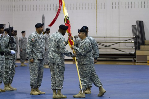 Lt. Col. Alexander Gallegos, commander of the 101st Special Troops Battalion, 101st Sustainment Brigade, 101st Airborne Division, passes the battalion colors to Command Sgt. Maj. Frank M. Graham, incoming senior adviser for the 101st STB during a change of responsibility ceremony Oct. 28 at Fort Campbell, Ky. During the ceremony, Command Sgt. Maj. Christopher T. Crawford relinquished his responsibilities as senior adviser of the 101st STB. (U.S. Army photo by Sgt. Leejay Lockhart)