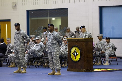 Lt. Col. Alexander Gallegos, commander of the 101st Special Troops Battalion, 101st Sustainment Brigade, 101st Airborne Division, speaks during the 101st STB change of responsibility ceremony Oct. 28 at Fort Campbell, Ky. During the ceremony, Command Sgt. Maj. Christopher T. Crawford (right) relinquished his responsibilities as senior adviser of the 101st STB to incoming Command Sgt. Maj. Frank M. Graham (left). (U.S. Army photo by Sgt. Leejay Lockhart)