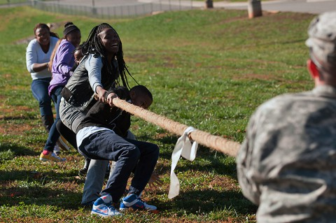 Students from West Creek Middle School in Clarksville, Tenn., take on Soldiers from the 551st Military Police Company, 716th Military Police Battalion, 16th Military Police Brigade, supported by the 101st Sustainment Brigade, 101st Airborne Division, in tug of war Nov. 7 at West Creek Middle School. (U.S. Army photo by Sgt. Leejay Lockhart)