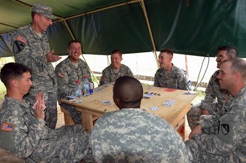 Soldiers with the 36th Engineer Brigade, Fort Hood, Texas, assigned to Joint Forces Command – United Assistance, pause their card game to talk with Maj. Gen. Gary Volesky, the commander of JFC-UA, at the National Police Training Academy, Monrovia, Liberia, Nov. 27, 2014. (Sgt. Ange Desinor, 13th Public Affairs Detachment)