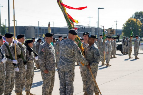 Lt. Col. Leevaine Williams Jr., the commander of the 716th Military Police Battalion, 16th Military Police Brigade, supported by the 101st Sustainment Brigade, 101st Airborne Division, passes the battalion colors to Command Sgt. Maj. John D. Vicars, the incoming senior enlisted adviser, during a change of responsibility ceremony Oct. 22, at Fort Campbell, Ky. The 716th MP Battalion is the U.S. Army's most decorated military police battalion and provides military police support to Fort Campbell and the 101st Airborne Division. (Sgt. Leejay Lockhart, U.S. Army)