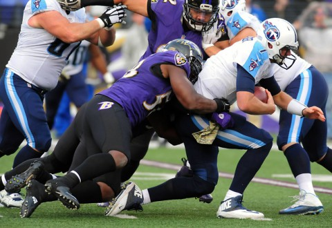Tennessee Titans quarterback Zach Mettenberger (7) is sacked by Baltimore Ravens linebacker Elvis Dumervil (58) in the fourth quarter at M&T Bank Stadium on November 9, 2014. (Evan Habeeb-USA TODAY Sports)