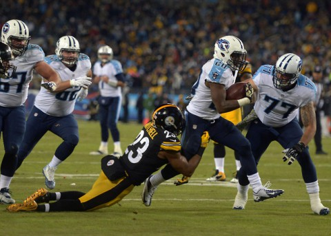 Tennessee Titans running back Bishop Sankey (20) is defended by Pittsburgh Steelers safety Mike Mitchell (23) on a 9-yard touchdown run in the first quarter at LP Field. (Kirby Lee-USA TODAY Sports)