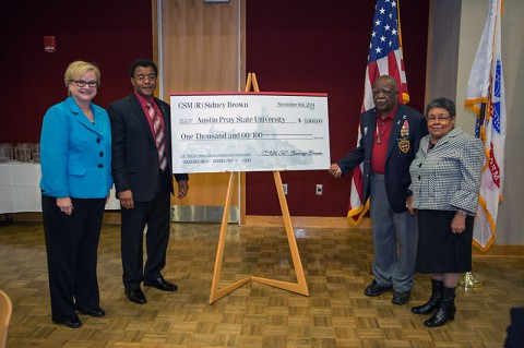 APSU President Alisa White, APSU Military Alumni Chapter President Joe Shakeenab, retired Command Sgt. Maj. Sidney Brown and his wife, Jimilla Brown. (Beth Liggett/APSU).