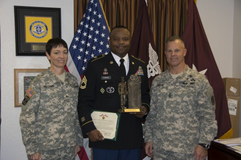 Brig. Gen. Barbara R. Holcomb and Command Sgt. Major Jayme Johnson congratulate Sgt. 1st Class Kenneth Parrish, Blanchfield Army Community Hospital Career Counselor, who was recently selected as the U.S. Army Medical Command Career Counselor of the Year. (Erin Perez/U.S. Army)