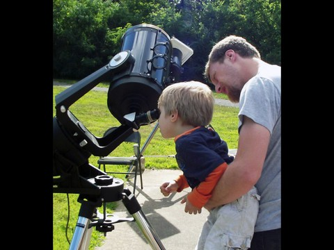 Child viewing through a telescope at Golden Pond Planetarium and Observatory. (Land Between the Lakes)