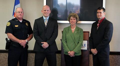 (Left to Right) Deputy Chief Michael Parr, Zachary Baggett, Mayor Kim McMillan, and Randolph Puskas.