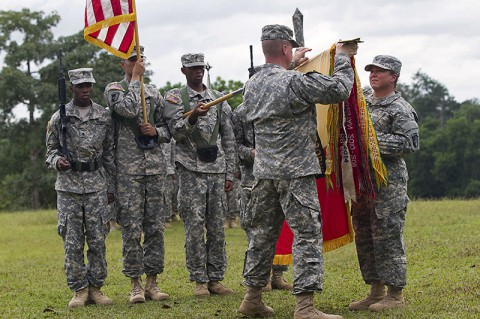 Col. Kimberly Daub, commander of the 101st Sustainment Brigade, Task Force Lifeliner, and Command Sgt. Maj. Ian Griffin, the brigade senior enlisted adviser, uncase their unit's colors in a ceremony held in Firestone, Monrovia Province, Liberia on Nov. 12, 2014. Task Force Lifeliner is the Joint Forces Command – United Assistance sustainment asset for the logistical efforts being made and planned for Operation United Assistance. (Sgt. 1st Class Mary Rose Mittlesteadt)