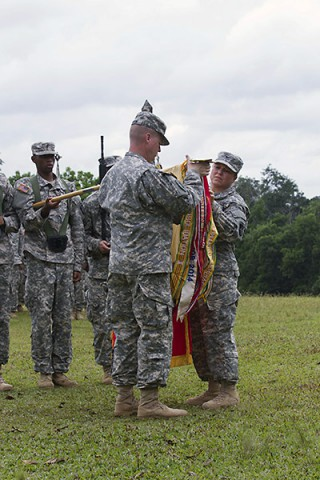 Col. Kimberly Daub, commander of the 101st Sustainment Brigade, Task Force Lifeliner, and Command Sgt. Maj. Ian Griffin, the brigade senior enlisted adviser, uncase their unit's colors in a ceremony held in Firestone, Monrovia Province, Liberia on Nov. 11, 2014. Task Force Lifeliner, the JTF-UA sustainment asset about the logistical efforts being made and planned for Operation United Assistance. (Sgt. 1st Class Mary Rose Mittlesteadt)
